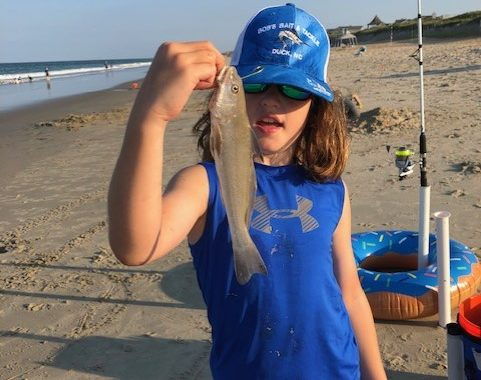 Micah catching sea mullet on OBX surf.