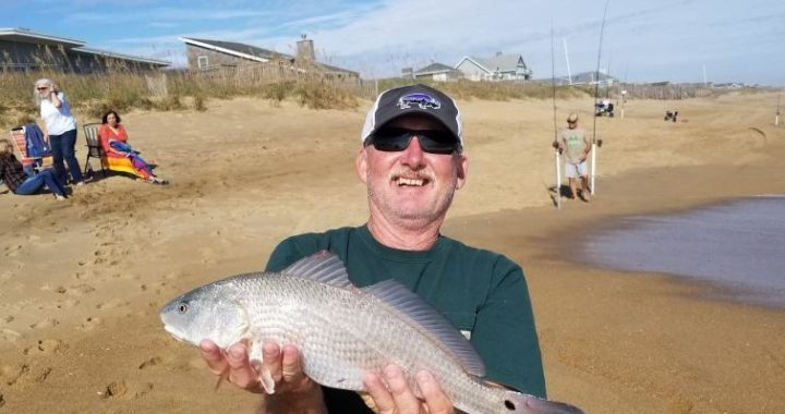 Bill with a red drum caught on surf OBX